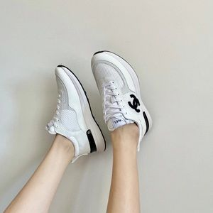 Chanel sneakers walk into boutique w/t confidence